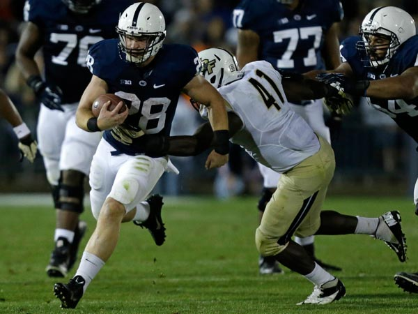 Penn St running back Zach Zwinak (28) runs past UCF linebacker Terrance Plummer (41) during the fourth quarter of an NCAA college football game in State College, Pa., Saturday, Sept. 14, 2013. UCF won 34-31. (Gene J. Puskar/AP)