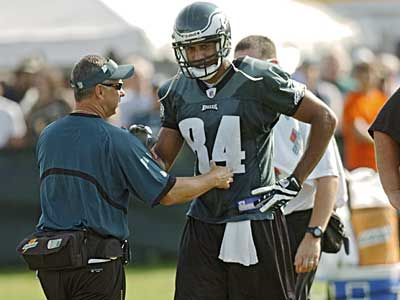 The Eagles have released WR Hank Baskett (84) and removed Michael Vick from the exempt list. (File photo)