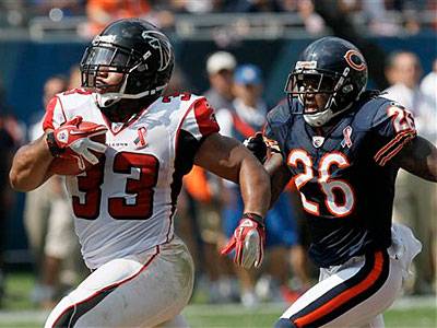 Falcons running back Michael Turner broke 38 tackles last year, according to Football Outsiders. (AP Photo / Charles Rex Arbogast)