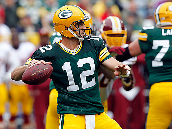 Aaron Rodgers and the Green Bay Packers will face the Baltimore Ravens this weekend. (Mike Roemer/AP file photo)