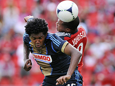 Sheanon Williams battles for the ball with Toronto FC´s Ryan Johnson during the first half. (AP/The Canadian Press)