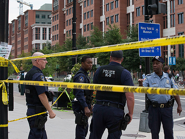 Police work the scene on M Street, SE in Washington, where a gunman was reported at the Washington Navy Yard. (Jacquelyn Martin/AP)