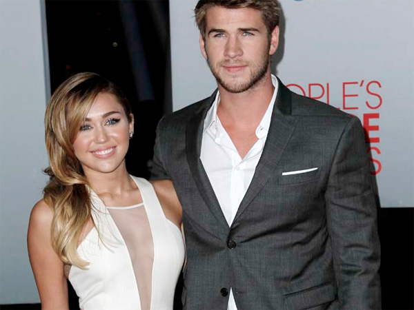 Miley Cyrus, left, and Liam Hemsworth arrive at the People´s Choice Awards on Wednesday, Jan. 11, 2012 in Los Angeles. (AP Photo/Matt Sayles)
