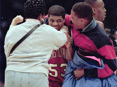 Jerome Allen celebrates with Penn fans after the Quakers´ 90-80 win over Nebraska at Nassau Coliseum in the 1994 NCAA Tournament. (Alejandro A. Alvarez/Daily News file photo)