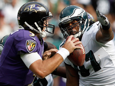 Cullen Jenkins goes after Baltimore Ravens quarterback Joe Flacco on Sunday. (Yong Kim/Staff Photographer)
