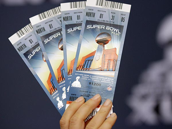 Anastasia Danias, NFL vice president for legal affairs, holds up examples of legal Super Bowl XLVI tickets during a security news conference Thursday, Feb. 2, 2012, in Indianapolis. (AP Photo/David J. Phillip)