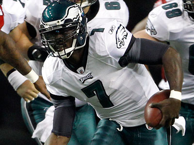 Eagles quarterback Michael Vick scrambles against the Falcons in the first quarter on Sunday night. (Yong Kim/Staff Photographer)