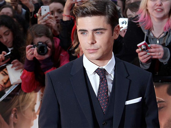 U.S actor Zac Efron arrives for the European Premiere of ´The Lucky One´, in London, Monday, April 23, 2012. (AP Photo/Joel Ryan)