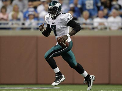 Michael Vick threw for 284 yards and two touchdowns against the Lions. (AP Photo / Paul Sancya)