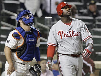 Ryan Howard hit a two-run home run in the top of the ninth inning on Wednesday against the Mets. (Frank Franklin II/AP)