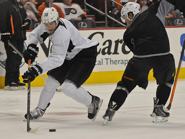 Brayden Schenn (left) and Kimmo Timonen skate during Flyers practice. (Ron Tarver/Staff file photo)