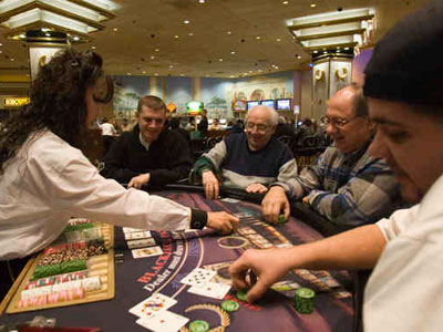 A blackjack dealer at work at Caesars Atlantic City. If table games are approved in Pennsylvania, a state senator estimates more than 10,000 jobs would be created, including dealers, pit bosses, and security - also creating a mighty task for the state Gaming Control Board and casino operators.