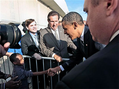 President Barack Obama reaches out to shake hands with a boy as he greets people on the tarmac during his arrival at John F. Kennedy International Airport, Monday, Sept., 19, 2011 in New York. (AP Photo / Pablo Martinez Monsivais)