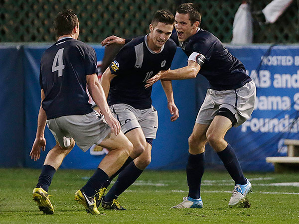 New Hope native Steve Neumann (center) helped lead Georgetown to the semifinals of last year´s NCAA College Cup. The forward is one of the top prospects for the upcoming MLS SuperDraft, which will take place in Philadelphia. (Dave Martin/AP file photo)