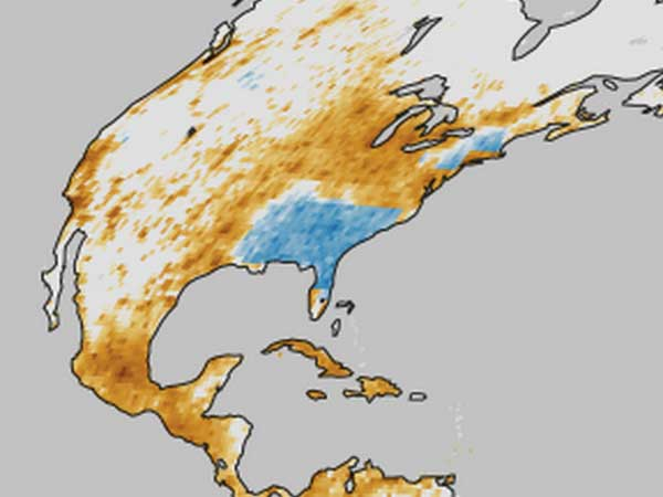 NASA map of North America showing premature deaths due to air pollution. Dark brown areas have more deaths than light brown regions; blue areas have seen a decline in deaths.