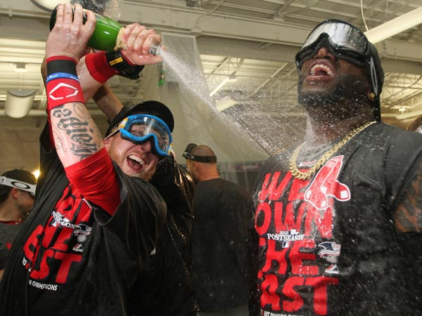 Boston Red Sox designated hitter David Ortiz, right, and teammate Mike Carp celebrate after the Red Sox clinched the AL East with a 6-3 win over the Toronto Blue Jays in a baseball game at Fenway Park, Friday, Sept. 20, 2013, in Boston. (Charles Krupa/AP)