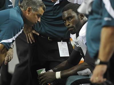Michael Vick was at practice today, but did not participate, as he recovers from a concussion. (AP Photo/John Amis, File)