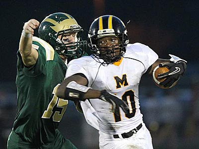 Moorestown&acute;s Anthony Bonett is taken down for a loss by Seneca<br />Marquis Arnold. (David M Warren/Staff Photographer)