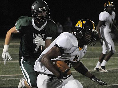 Moorestown´s Sidney Ruffin runs the ball in the third quarter. He´s trailed by Camden Catholic´s Nick Tretina. (Photo credit: Curt Hudson)