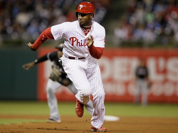 Domonic Brown in action during a baseball game against the Miami Marlins, Wednesday, Sept. 18, 2013, in Philadelphia. (Matt Slocum/AP)