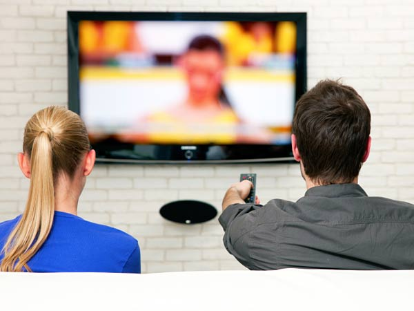 A couple watches television together. (iStock Photo)