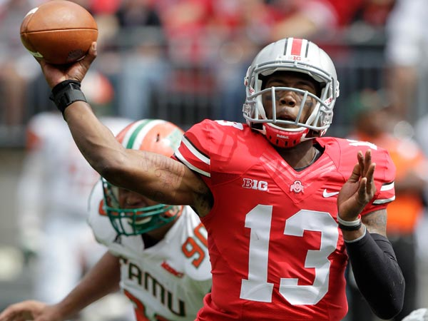 Ohio State quarterback Kenny Guiton throws a pass against Florida A&M during the second quarter of an NCAA college football game Saturday, Sept. 21, 2013, in Columbus, Ohio. (Jay LaPrete/AP)