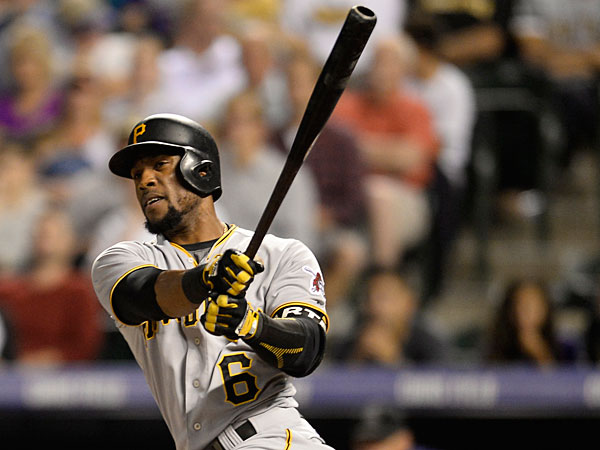 Pittsburgh Pirates left fielder Starling Marte (6) singles in the fourth inning against the Colorado Rockies at Coors Field.