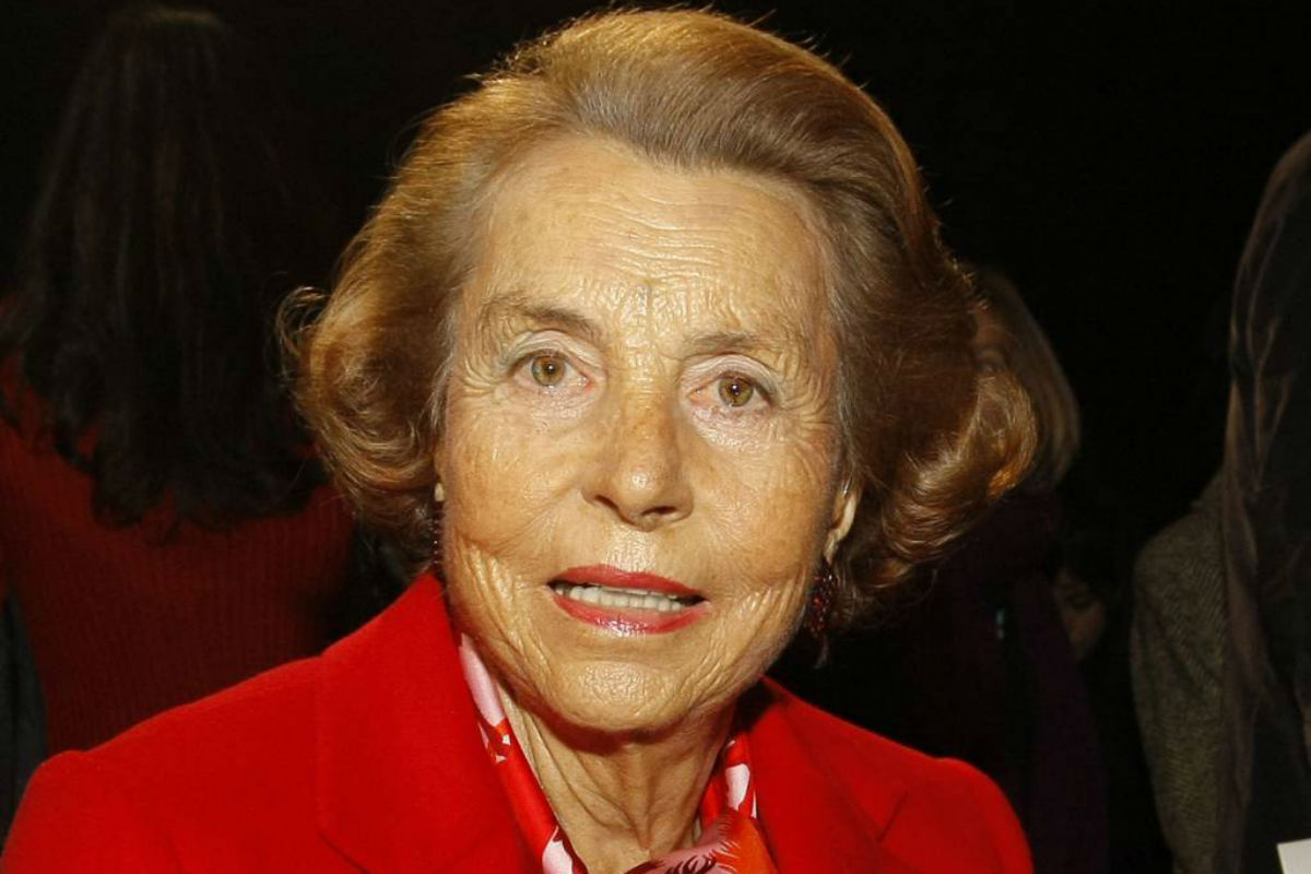 FILE - In this Wednesday Jan. 26, 2011file photo, l´Oreal cosmetics heiress Liliane Bettencourt attends Franck Sorbier´s spring/summer 2011 Haute Couture fashion collection, in Paris, Paris. L´Oreal cosmetics heiress Liliane Bettencourt has died at the age of 94 at her home, her family announced.