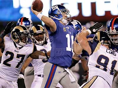 Giants quarterback Eli Manning has been sacked seven times in two games. (Julio Cortez/AP)