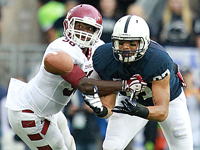 Temple´s Olaniyi Adewole covers Penn State´s Kyle Carter in the first half. (David Swanson/Staff Photographer)