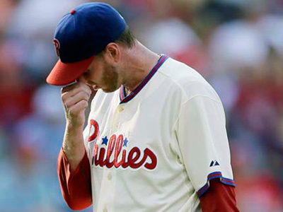 Roy Halladay wipes his face as he walks off the field after being<br />pulled in the second inning on Saturday. (Matt Slocum/AP)