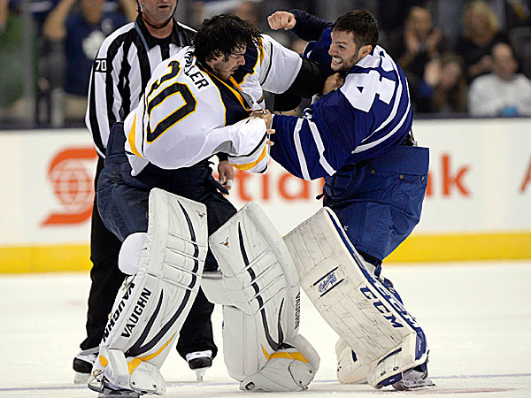 Sabres goalie Ryan Miller fights with Maple Leafs goalie Jonathan Bernier. (Frank Gunn/The Canadian Press/AP)