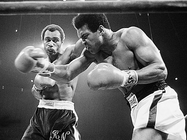 Muhammad Ali winces as Ken Norton hits him with a left to the head. (AP file photo)