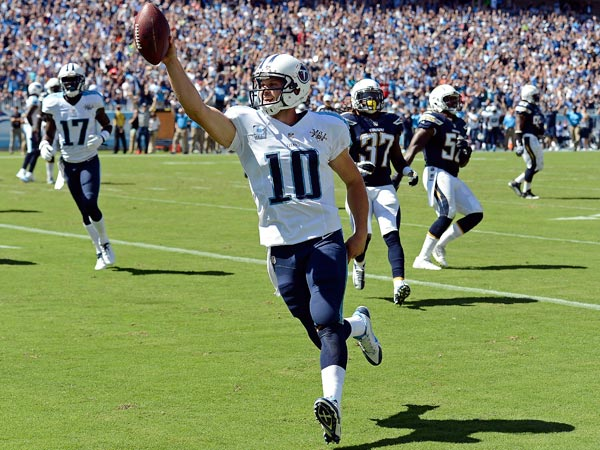 Titans quarterback Jake Locker (10) celebrates as he scores a touchdown on a 7-yard run against the San Diego Chargers in the second quarter of an NFL football game on Sunday, Sept. 22, 2013, in Nashville, Tenn. (Mark Zaleski/AP)