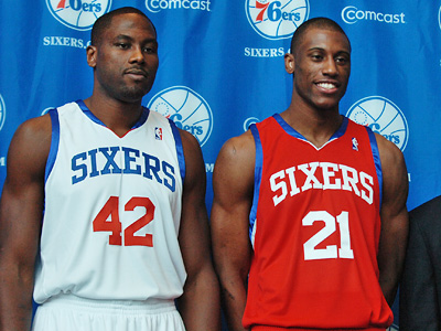 Elton Brand (left) and Thaddeus Young pose at a Sixers press conference in their new team jerseys.  (Sarah J. Glover / Staff Photographer)