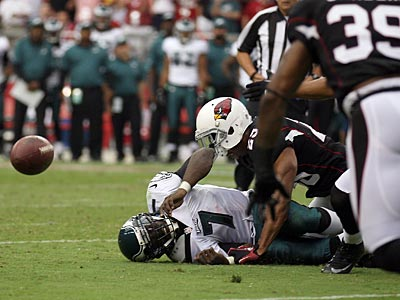 Michael Vick fumbled the ball at the end of the first half, which led to a Cardinals touchdown. (Yong Kim/Staff Photographer)