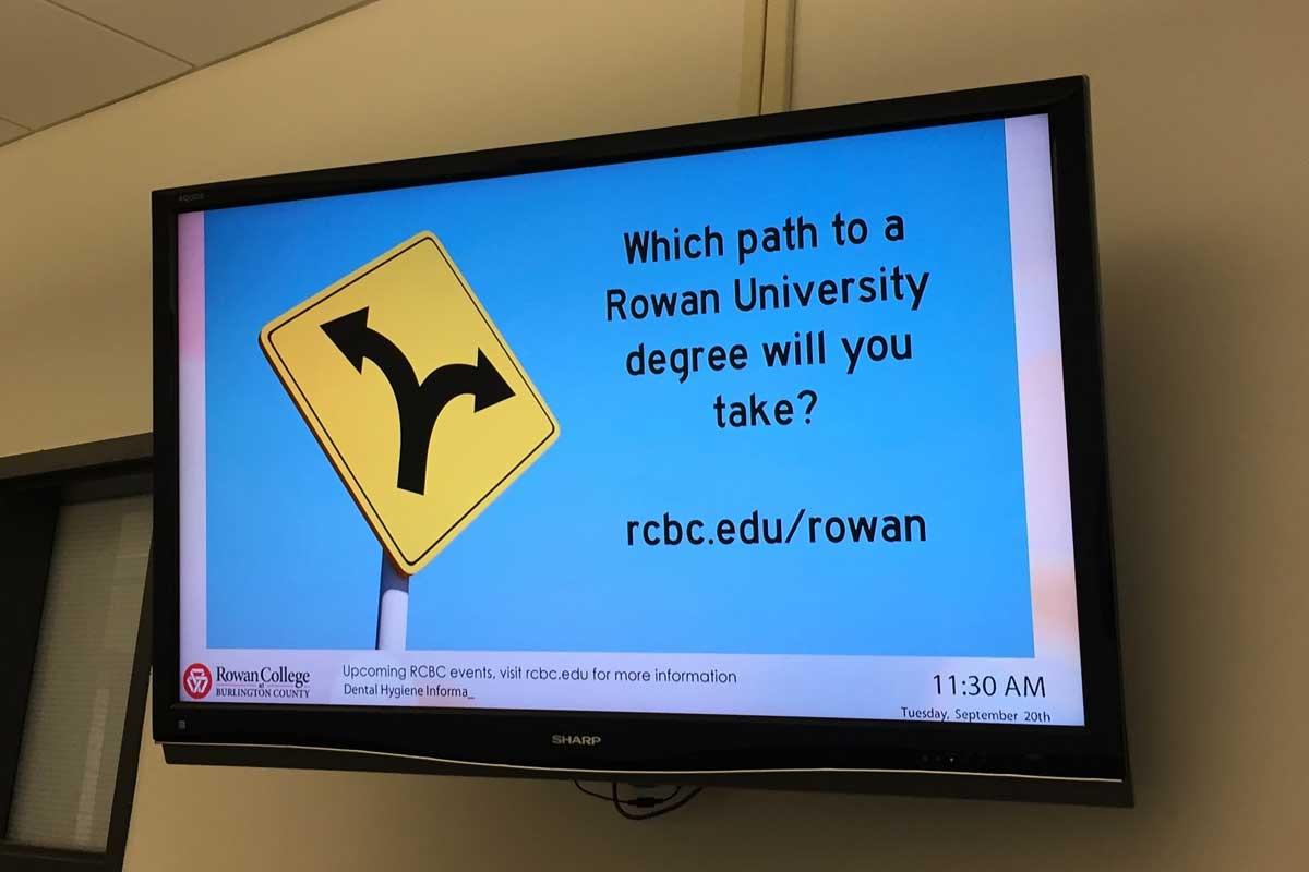 A digital sign at rowan college at burlington county s mount laurel campus promotes the school s rowan university partnership jonathan lai staff