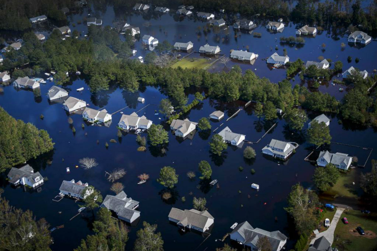 Dozens of homes are surrounded by floodwaters brought to the area by Hurricane Florence in Pender County, N.C., on Saturday, Sept. 22, 2018. The floodwaters have swallowed an estimated 25 percent of Pender County.