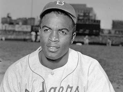 Jackie Robinson in 1948. A year earlier, he made his debut as a major-leaguer, and broke the color barrier in modern-era baseball. (AP Photo)