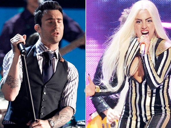Adam Levine at the 54th annual Grammy Awards on Sunday, Feb. 12, 2012 in Los Angeles. Lady Gaga, right, performs on tour. (AP Photo/Matt Sayles)