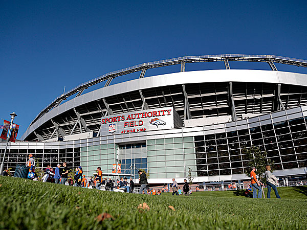 Football fans walk into Sports Authority Field at Mile High Stadium. (Joe Mahoney/AP)