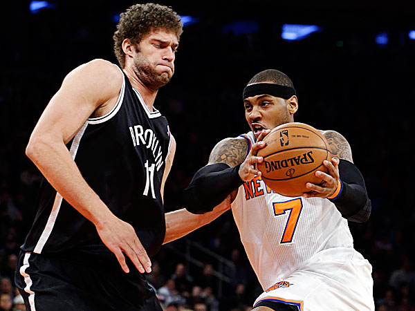Knicks forward Carmelo Anthony drives against Nets center Brook Lopez. (Kathy Willens/AP)