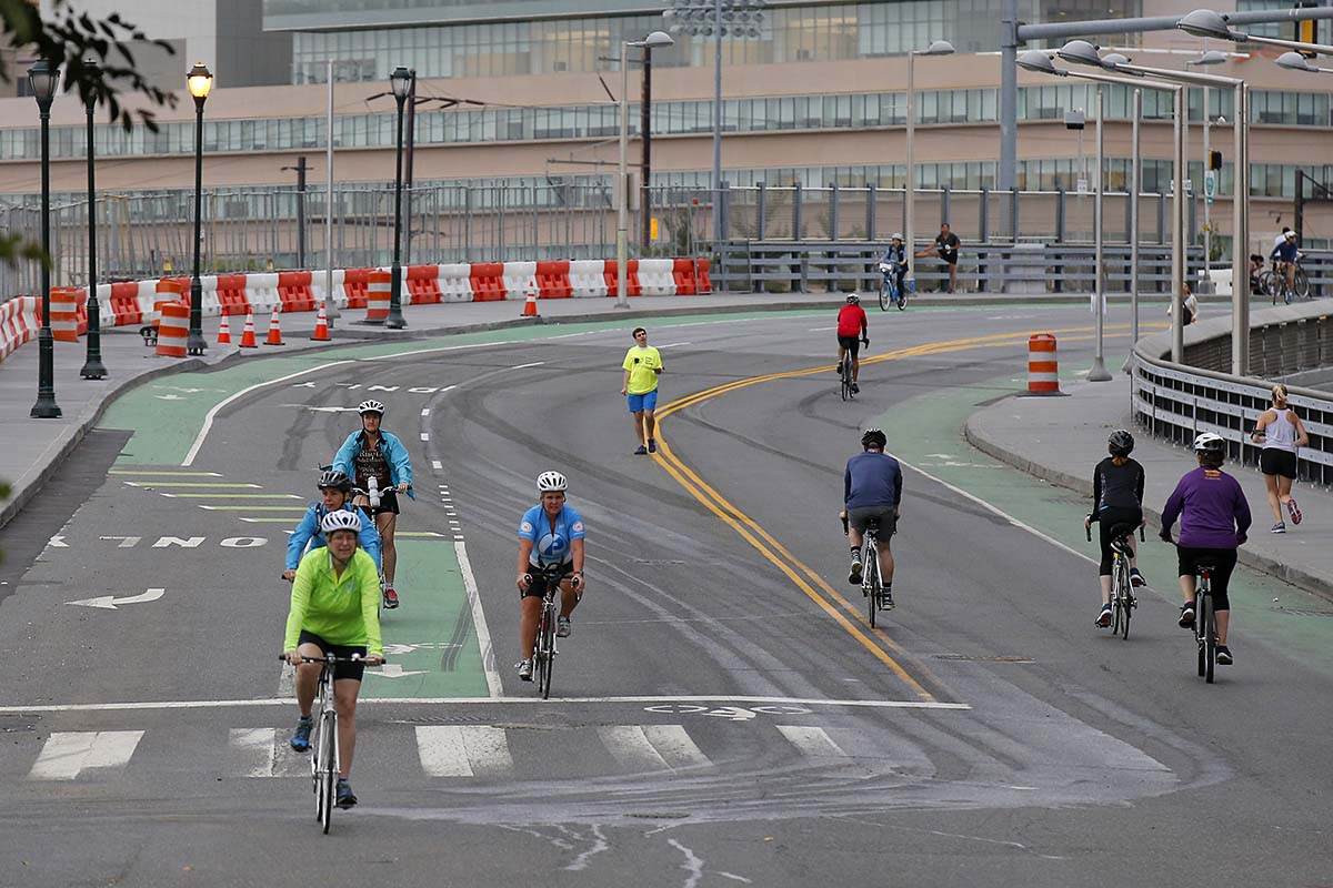 Bicyclists ride on the South Street Bridge during Philly Free Streets on Saturday.