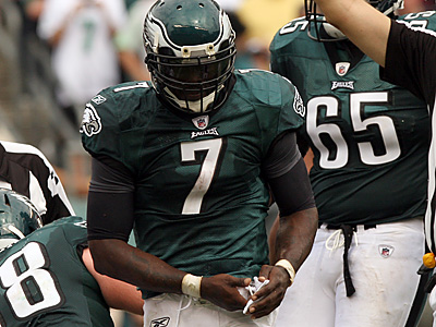 Michael Vick holds his broken right hand. (Yong Kim/Staff Photographer)