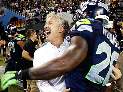 Seahawks head coach Pete Carroll celebrates with Michael Robinson after defeating the Packers. (Ted S. Warren/AP)