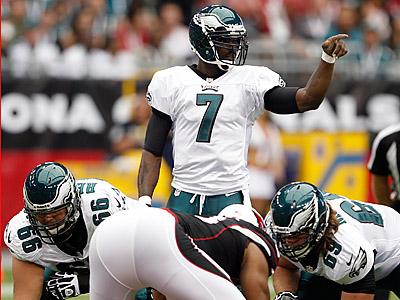 Michael Vick points out a new protection scheme during the Eagles loss to the Cardinals. (Yong Kim/Staff Photographer)