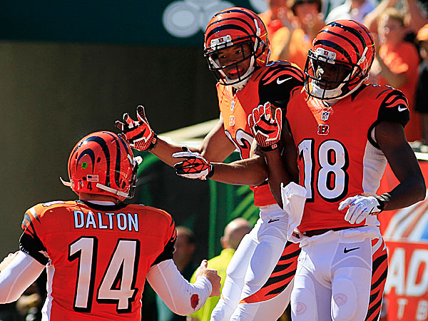 Bengals wide receiver A.J. Green celebrates with wide receiver Mohamed Sanu after Green caught a touchdown pass from quarterback Andy Dalton. (Tom Uhlman/AP)