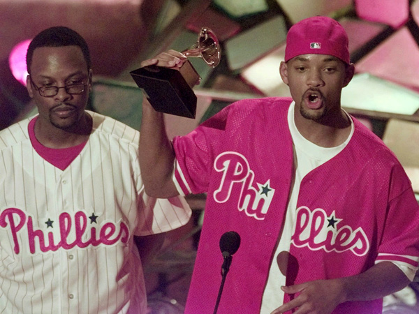 "Will Smith, right, holds the Grammy for Best Rap Solo for the song ""Men In Black"" as  D.J. Jazzy Jeff looks on at the 40th Annual Grammy Awards Wednesday, Feb. 25, 1998, at Radio City Music Hall in New York.  (AP Photo/Mark Lennihan)"