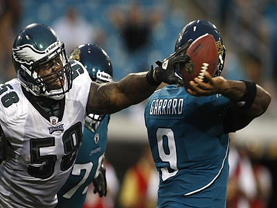 Trent Cole knocks the ball away from David Garrard as he attempts to throw. (Ron Cortes/Staff Photographer)