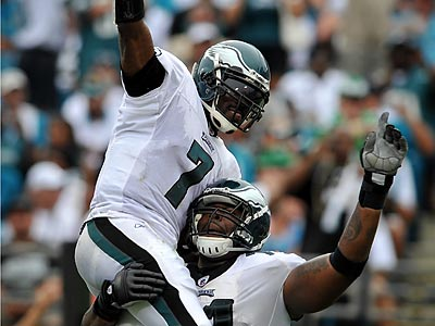 Michael Vick celebrates with Jason Peters after throwing a touchdown pass in the second quarter. (AP Photo/Stephen Morton)
